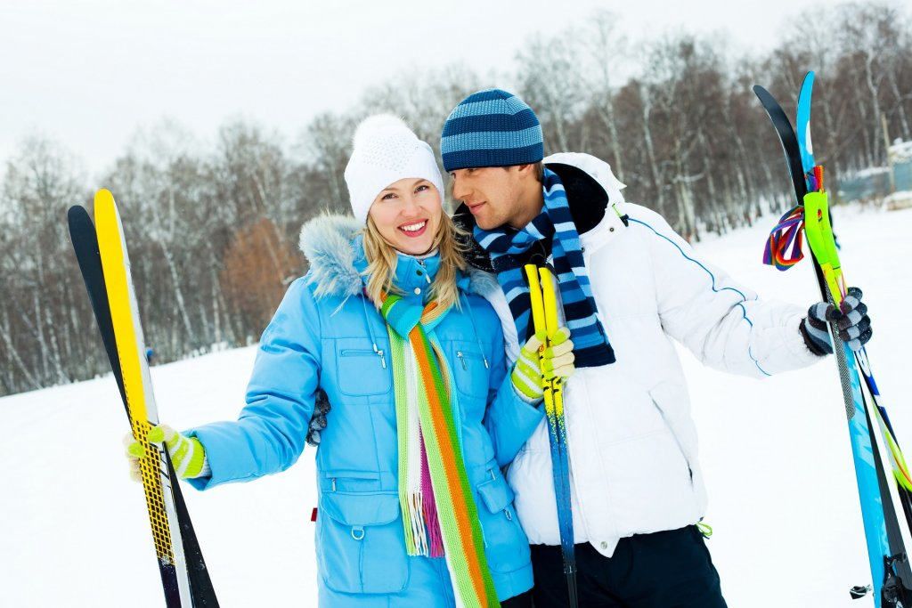 happy young couple going skiing on a warm winter day