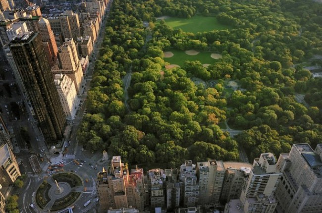 Aerial view of Central Park and Columbus Circle, Manhattan, New York; Park is surrounded by skyscraperCentral Park aerial view, Manhattan, New York; Park is surrounded by skyscraper